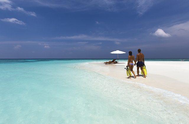 honeymoon couple on the beach